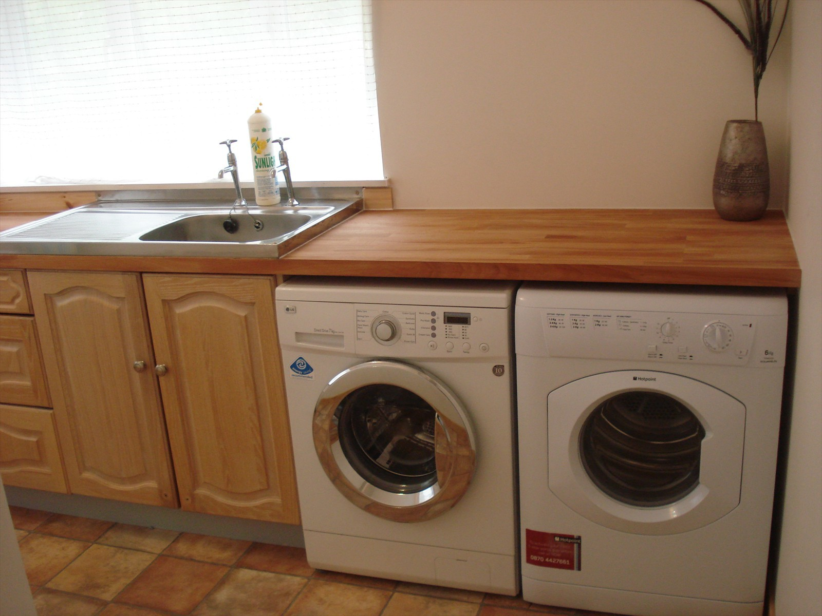 utility room with washing machine and dryer